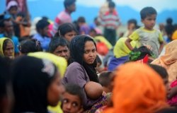 Rohingya refugees cross into the mainland after arriving in Bangladesh